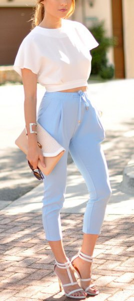 white ruffle short sleeve cropped top with light blue high waisted pants