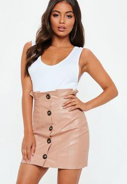 white scoop neck tank top with pink high waisted button front mini leather skirt