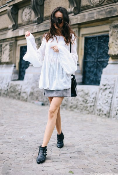 white semi sheer bell sleeve relaxed fit top with grey mini skirt