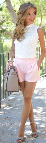 white sleeveless lace blouse with pale pink shorts