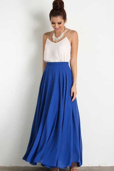 white spaghetti strap vest top with blue high waisted maxi flared skirt