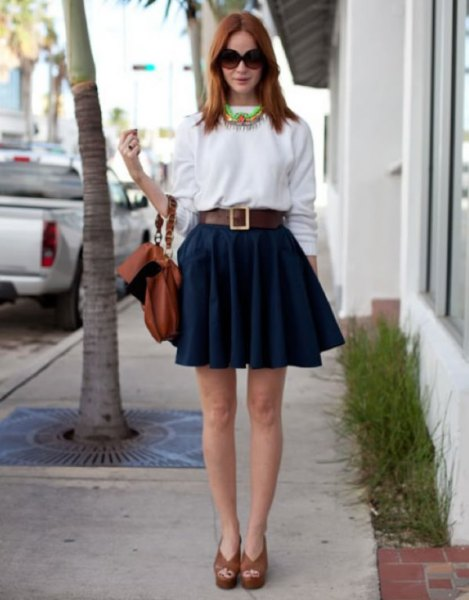 white sweatshirt with navy mini pleated skater skirt and belt
