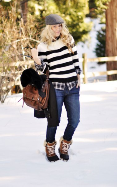 wide striped sweater with jeans and brown and black snow boots
