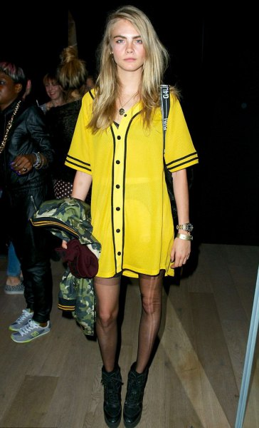 yellow and black printed t shirt dress with stockings and boots