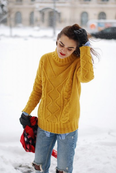 yellow cable knit mock neck sweater with ripped boyfriend jeans