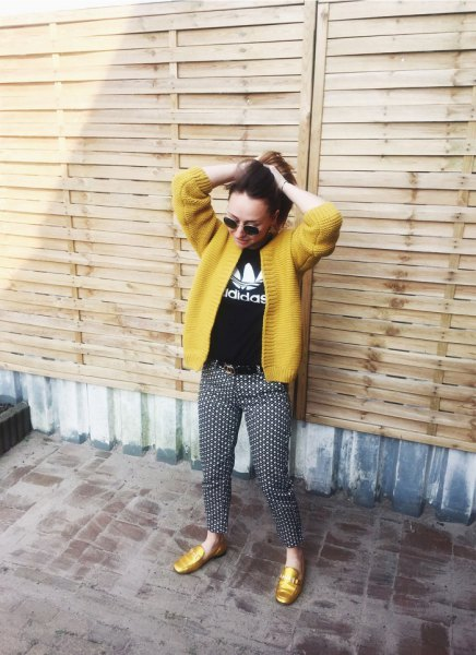 yellow cardigan with black print tee and polka dot pants