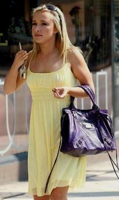 yellow chiffon babydoll mini dress with black leather purse