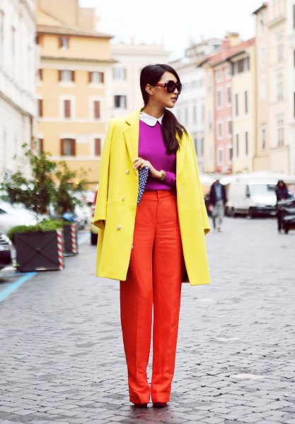 yellow coat with purple sweater and orange pants
