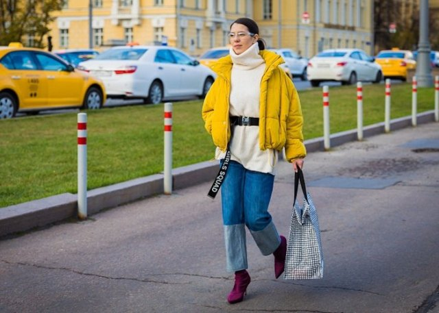 yellow jacket with black turtleneck chunky sweater and wide leg jeans