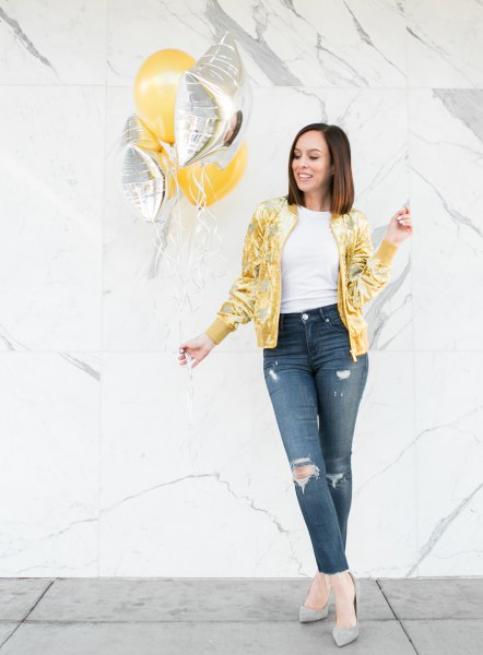 yellow metallic bomber jacket with dark blue skinny jeans