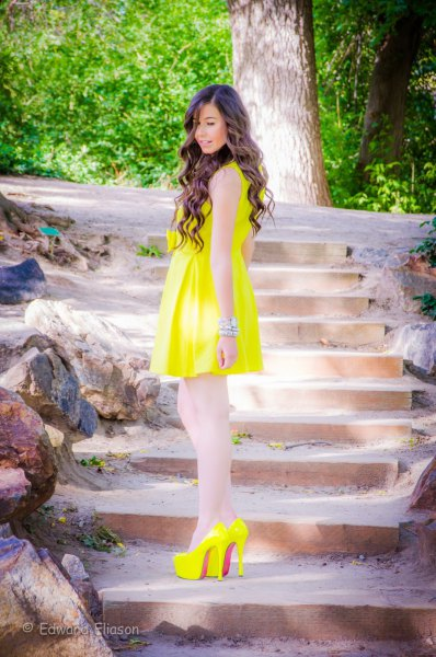 yellow sleeveless flared mini dress with matching high heels