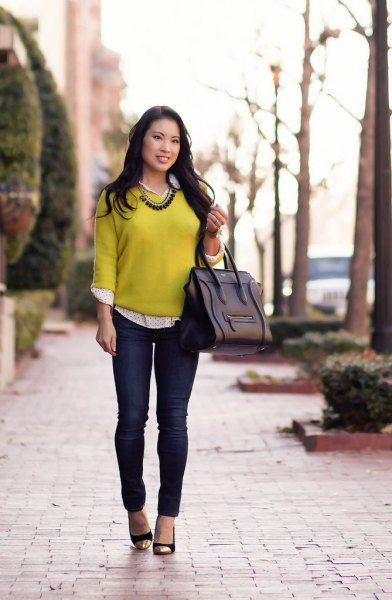 yellow sweater with white and black polka dot shirt