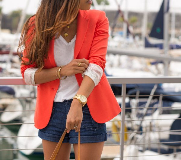 best orange fitted blazer with white v neck tee and navy blue mini shorts