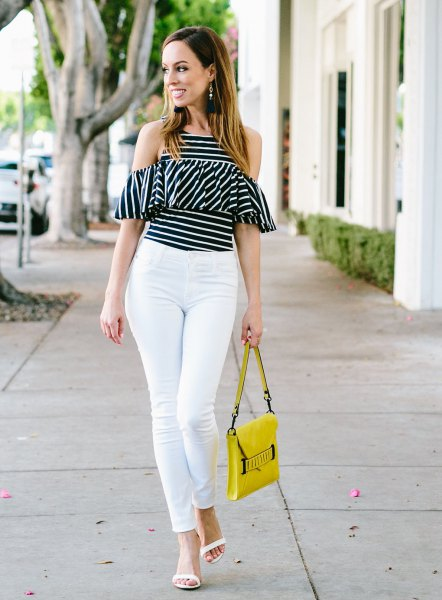 black and white striped cold shoulder ruffle top with yellow leather purse