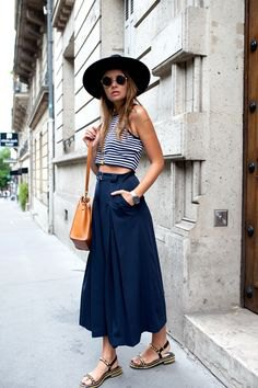black and white striped cropped tank top with navy blue maxi flared skirt