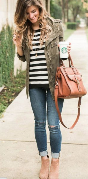 black and white striped t shirt with military jacket and jeans