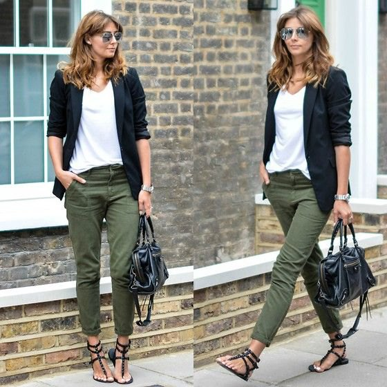 black blazer with white v neck top and green slim cut pants
