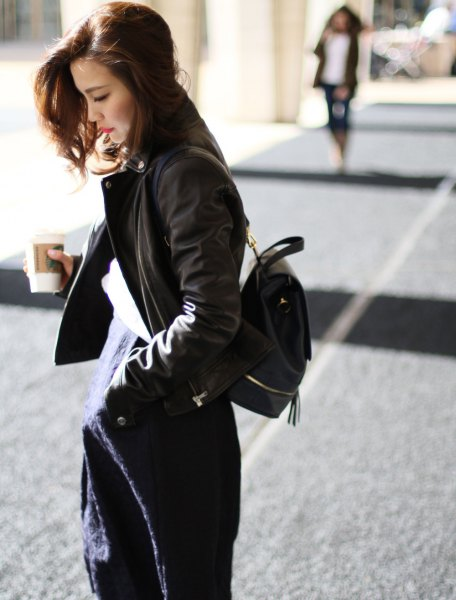 black bomber jacket with navy midi shift dress with backpack purse