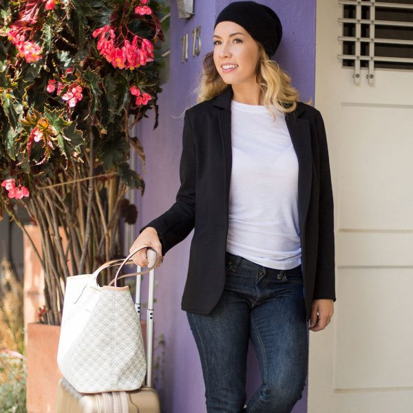black casual blazer with dark blue skinny jeans and knit hat