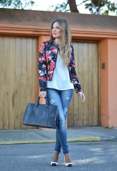 black fitted floral blazer with white relaxed fit top and ankle skinny jeans