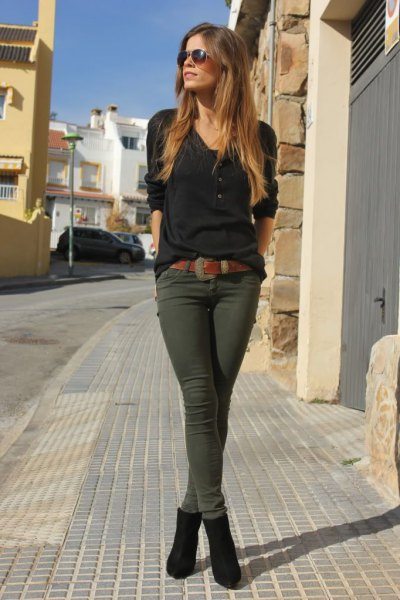 black half sleeve v neck tee with dark olive green skinny pants