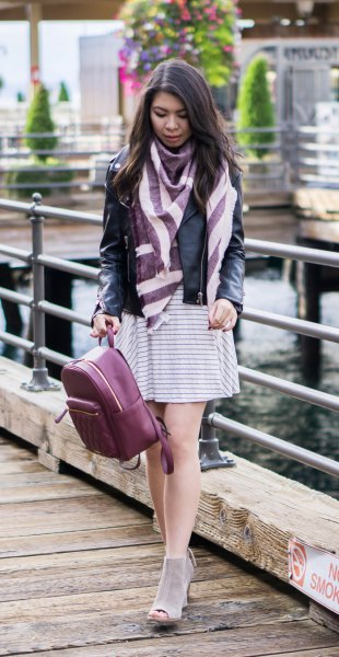 black leather jacket with grey and white striped mini shift dress