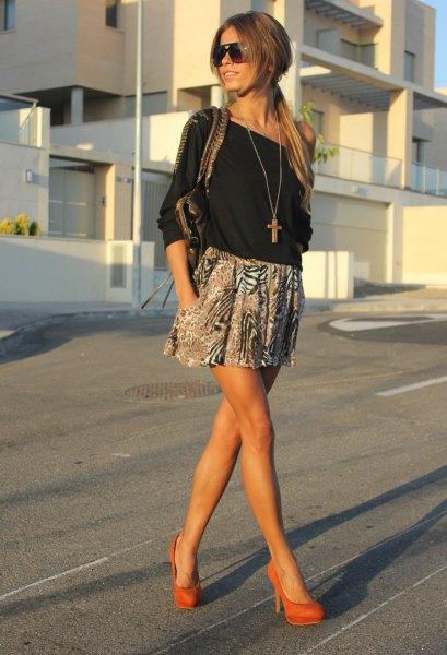 black off the shoulder blouse with printed mini skater skirt and orange heels
