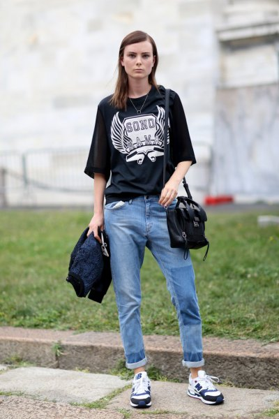black oversized print tee with cuffed relaxed fit blue jeans