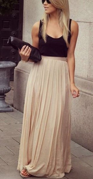 black scoop neck tank top with pale pink floor length chiffon skirt