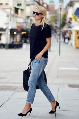 black t shirt with blue cuffed loose fit jeans
