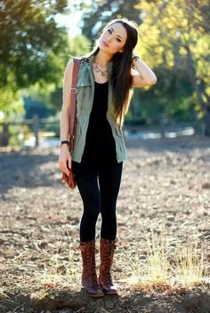 black tank top with matching skinny jeans and mid calf lace up boots