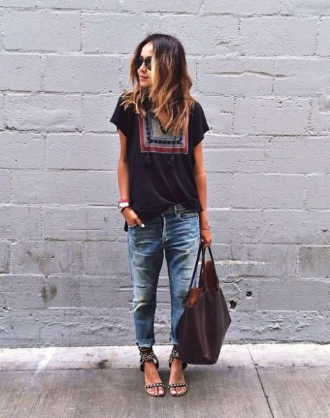 black tribal print t shirt with heavily ripped and washed boyfriend jeans