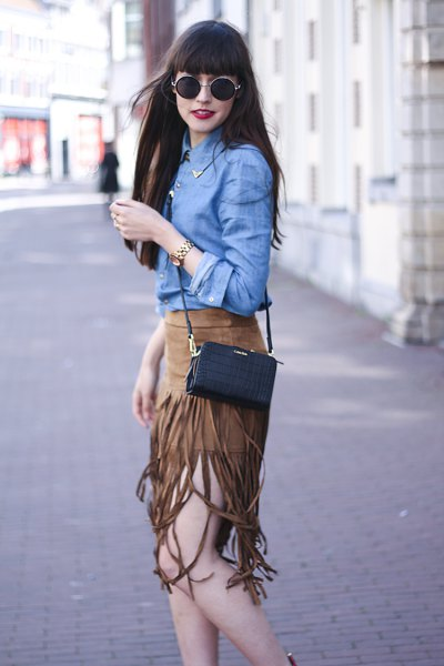 blue chambray shirt with green suede fringe skirt