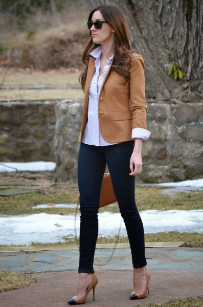 camel jacket with light blue button up shirt and chinos