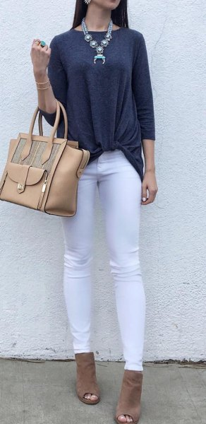 dark grey three quarter sleeve top with white jeans and open toe boots