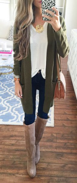 green cardigan with white top and grey knee high boots