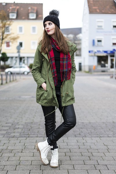 green long jacket with red and black plaid scarf