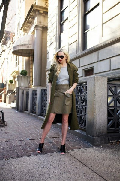 green longline wool coat with olive leather mini skirt