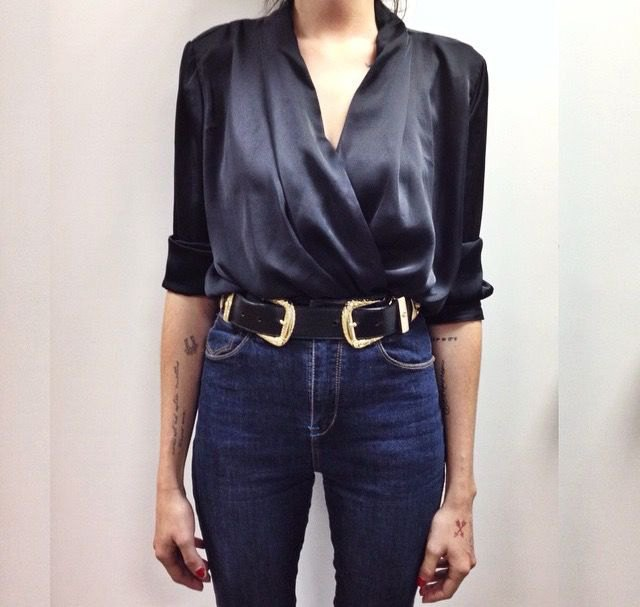 green satin v neck blouse with high rise blue jeans