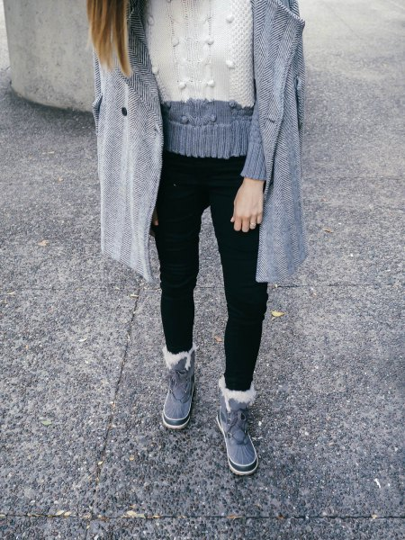 grey and white color block knit sweater with black jeans