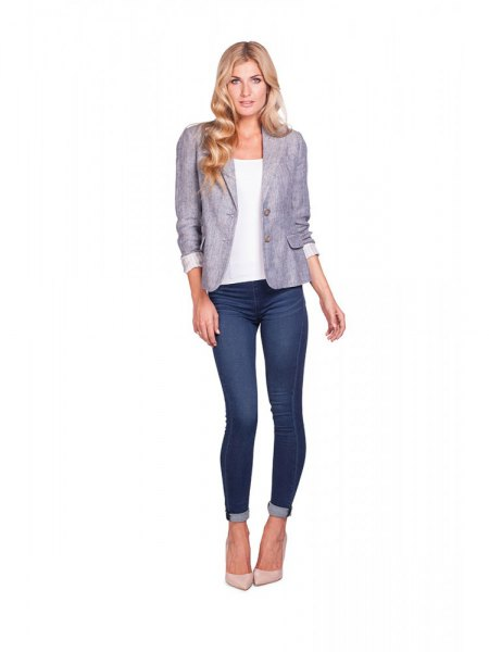 grey blazer with white top and dark blue cuffed skinny jeans