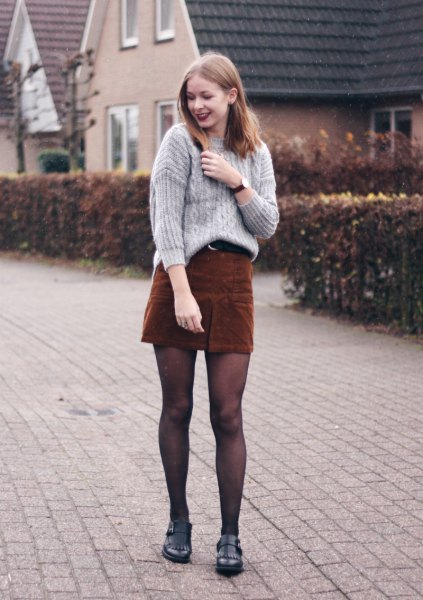 grey cable knit sweater with deep brown mini skirt