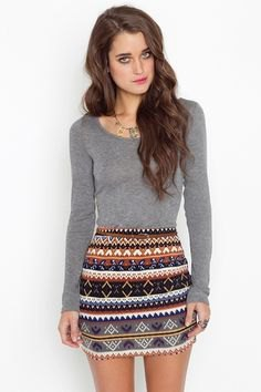 grey long sleeve top with tribal printed mini skirt