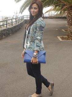 grey printed blazer with blue leather clutch bag