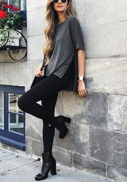 grey side slit shirt with black skinny jeans and ankle boots