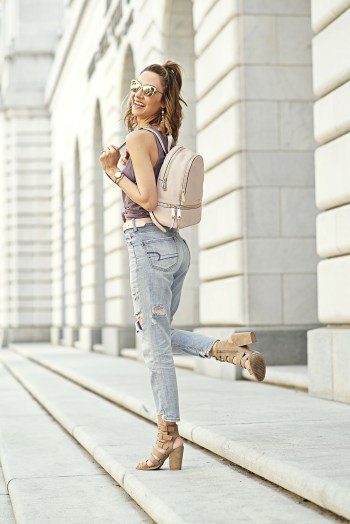 grey tank top with boyfriend jeans and pale pink leather backpack purse