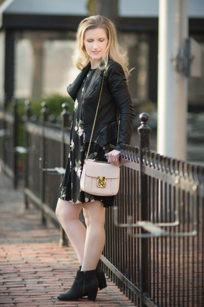 leather jacket with black floral swing mini dress and heeled boots