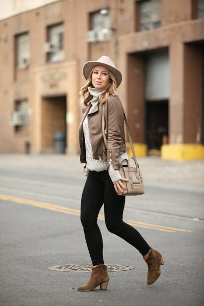 leather jacket with grey turtleneck sweater and white felt hat