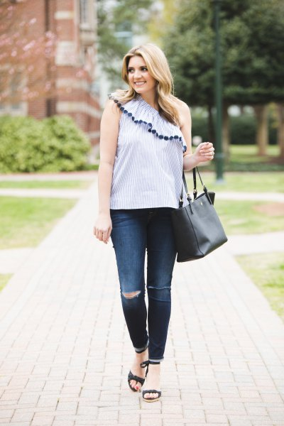 light blue one shoulder ruffle sleeveless top with skinny jeans