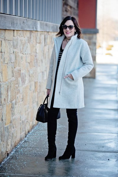 light grey cocoon coat with black and white striped tank top